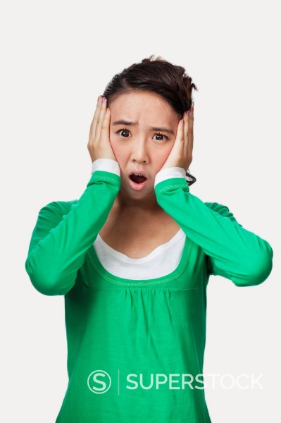 Stock Photo: 1589R-169861 Surprised Chinese woman with head in hands