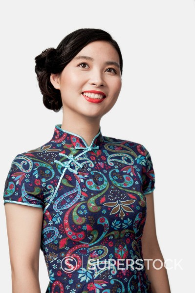 Smiling Chinese woman in traditional clothing : Stock Photo