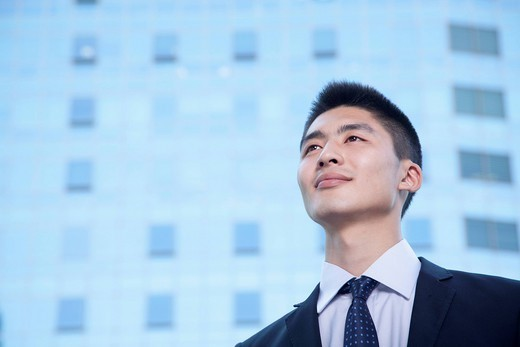 Smiling Chinese businessman : Stock Photo