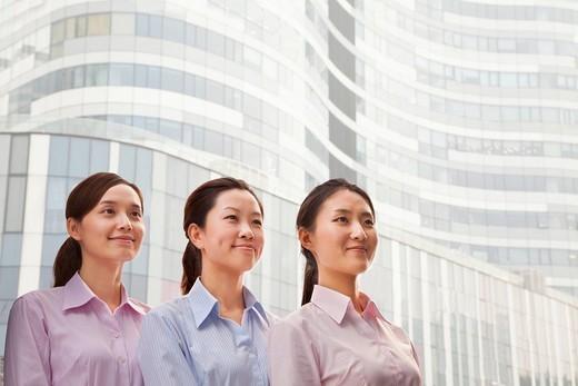 Smiling Chinese businesswomen : Stock Photo