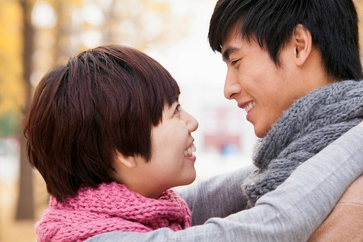 Chinese couple hugging : Stock Photo