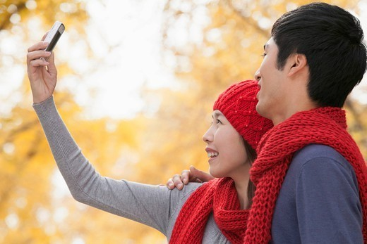 Chinese couple taking self_portrait : Stock Photo
