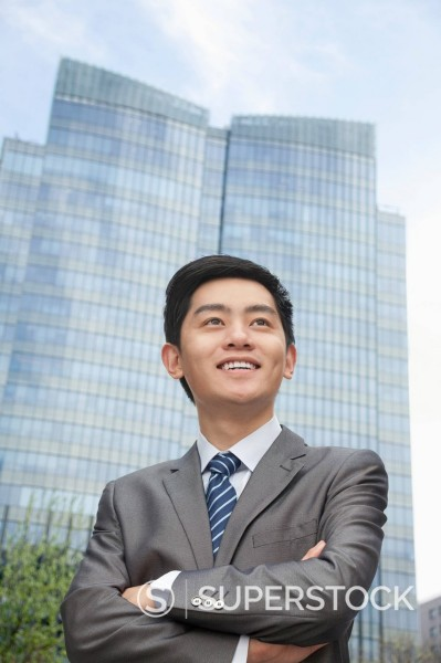 Stock Photo: 1589R-170145 Chinese businessman with arms crossed