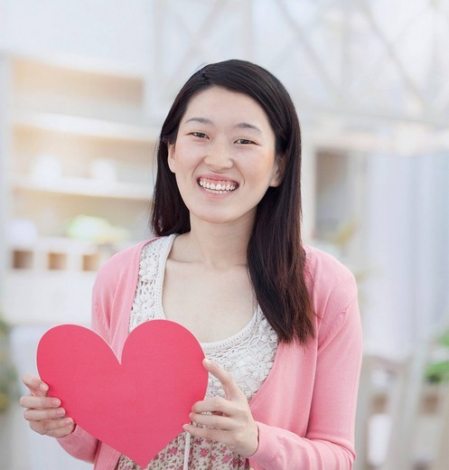 Chinese woman holding Valentine heart : Stock Photo