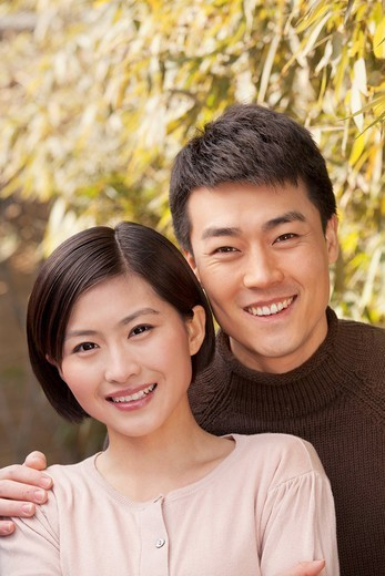 Smiling Chinese couple : Stock Photo