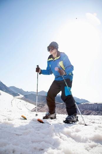 Chinese skier on ski slope : Stock Photo