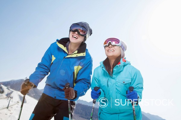 Chinese couple skiing : Stock Photo