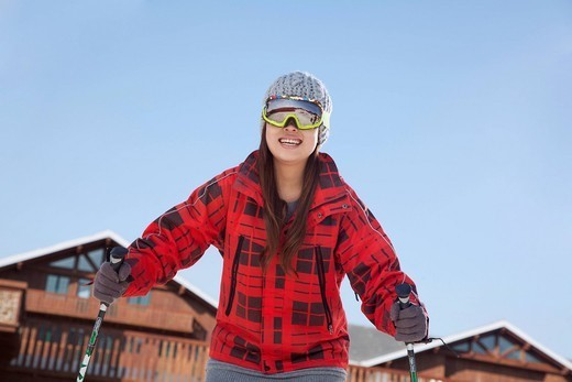 Smiling Chinese skier : Stock Photo