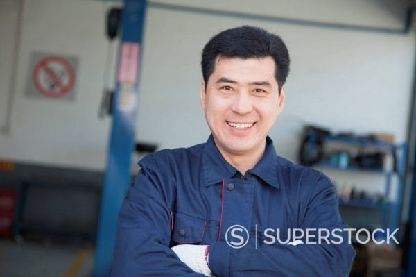 Stock Photo: 1589R-170311 Chinese mechanic standing with arms crossed
