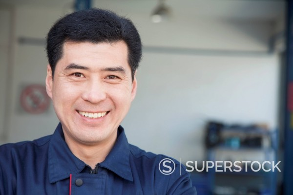 Stock Photo: 1589R-170312 Smiling Chinese mechanic