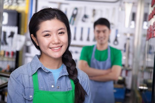 Chinese workers in workshop : Stock Photo