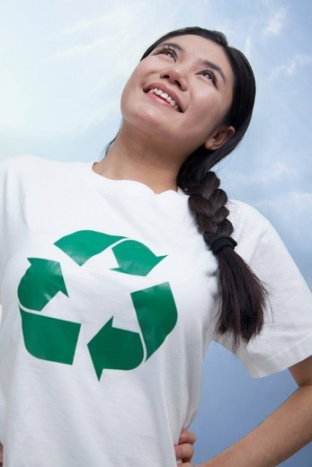 Chinese woman with recycling symbol on t_shirt : Stock Photo