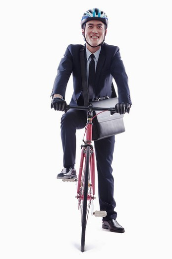 Chinese businessman with bicycle : Stock Photo