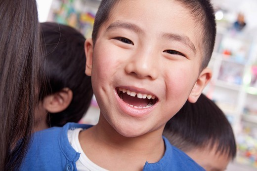 Smiling Chinese boy : Stock Photo