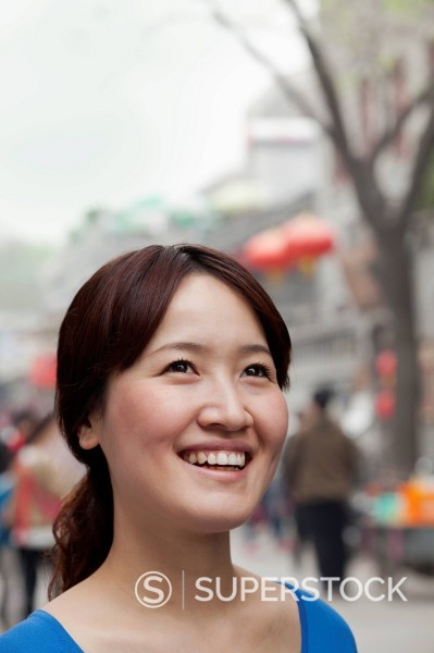 Smiling Chinese woman : Stock Photo