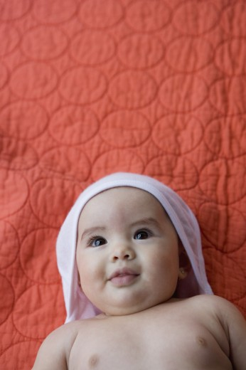 Infant lying on a blanket : Stock Photo