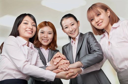Chinese businesswoman holding hands : Stock Photo