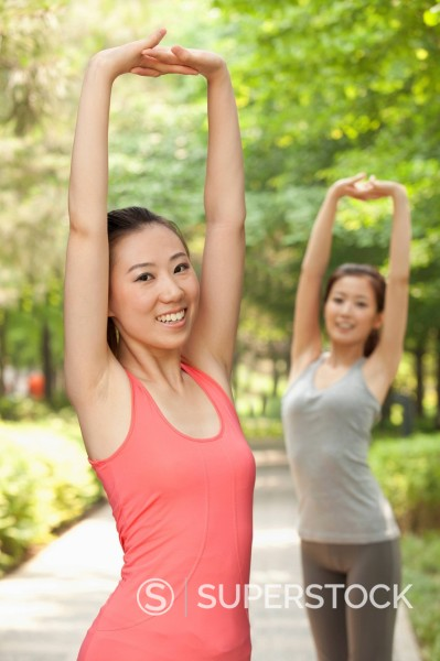Chinese women stretching before exercise : Stock Photo