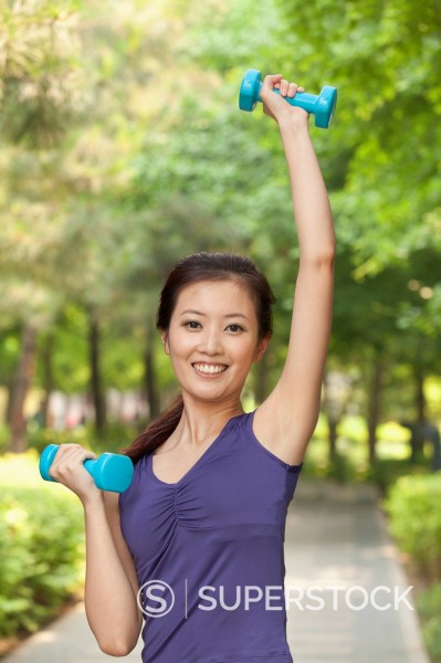 Stock Photo: 1589R-170526 Chinese woman lifting dumbbells