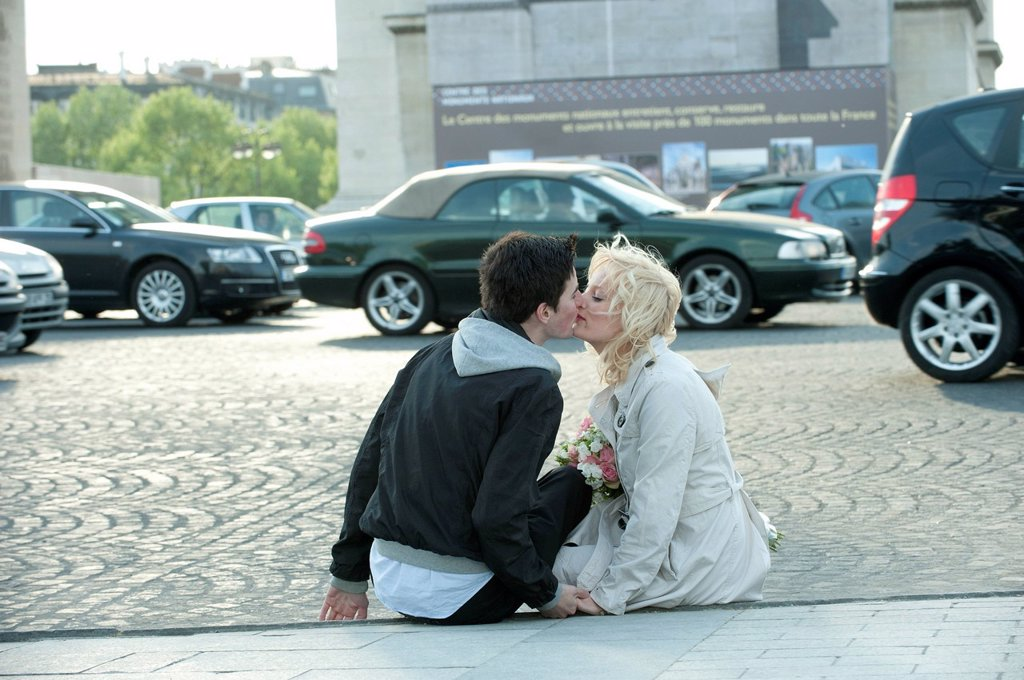 Stock Photo: 1589R-171163 Caucasian man kissing girlfriend on busy street
