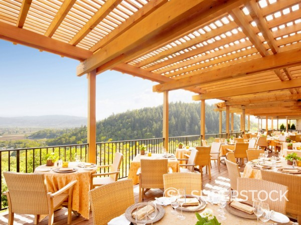 Stock Photo: 1589R-171181 Empty restaurant deck overlooking wine country at a luxury resort in Napa Valley, California