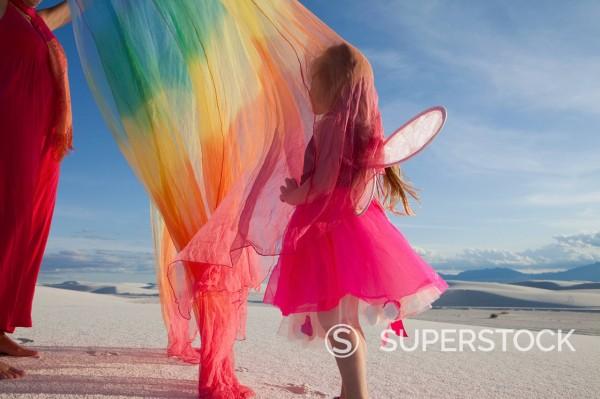 Caucasian girl in fairy costume in desert : Stock Photo
