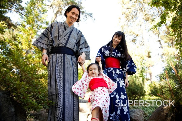 Stock Photo: 1589R-171257 Mixed race family in garden wearing Japanese kimonos