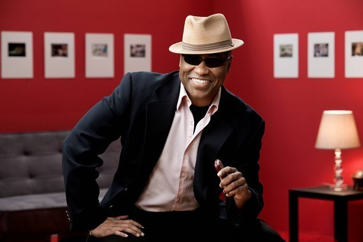 Smiling black man in suit, sunglasses and hat : Stock Photo