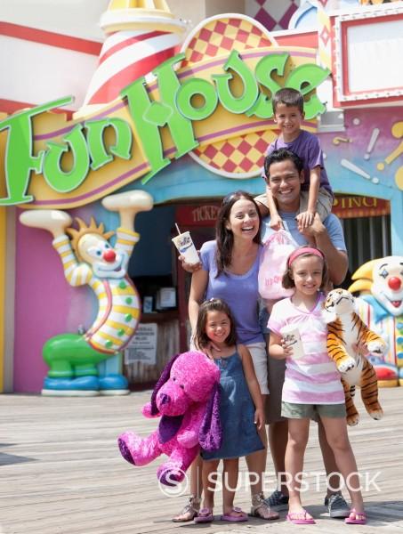 Hispanic family enjoying amusement park : Stock Photo