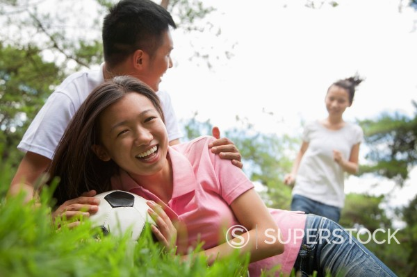 Stock Photo: 1589R-171317 Chinese couple playing with soccer ball