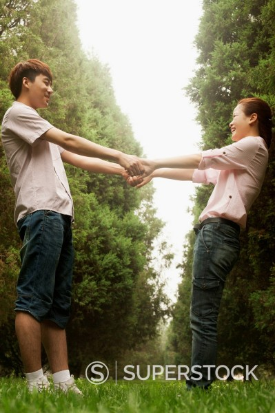 Stock Photo: 1589R-171369 Chinese couple playing in park