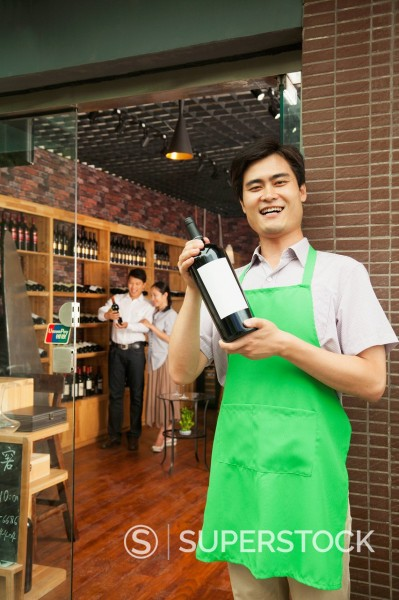 Stock Photo: 1589R-171394 Chinese man working in wine shop