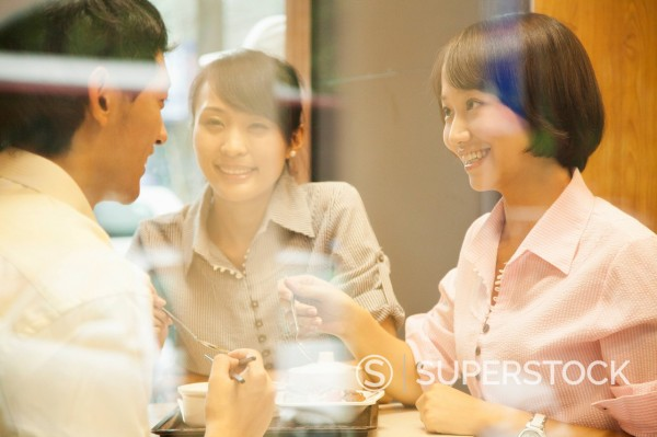 Stock Photo: 1589R-171442 Chinese friends eating together in cafe
