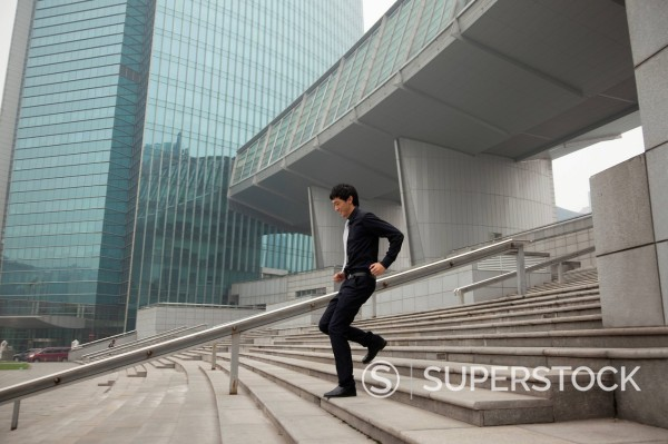 Stock Photo: 1589R-171523 Chinese businessman on city steps