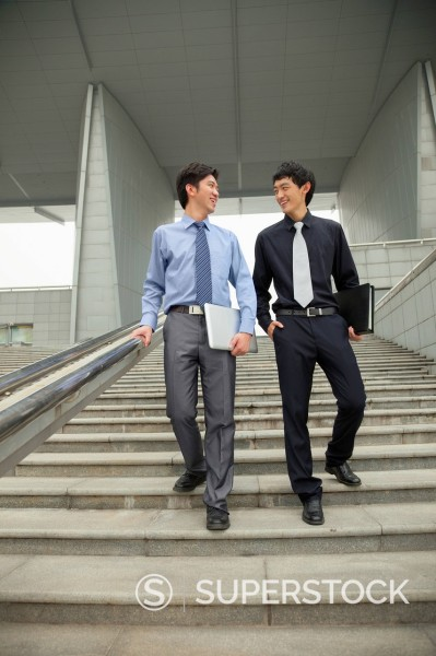 Stock Photo: 1589R-171532 Chinese businessmen talking on city steps