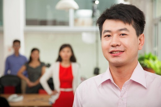Chinese businessman smiling : Stock Photo