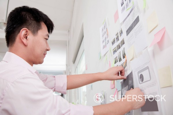 Chinese businessman making display in office : Stock Photo