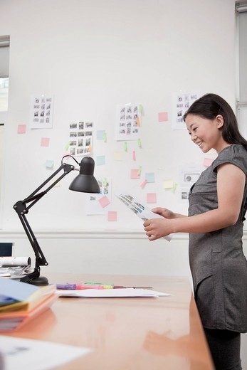 Chinese businesswoman working in office : Stock Photo