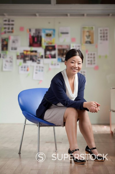 Stock Photo: 1589R-171637 Chinese businesswoman in chair in office