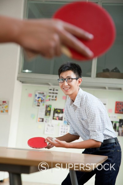 Stock Photo: 1589R-171655 Chinese businessmen playing ping pong in office