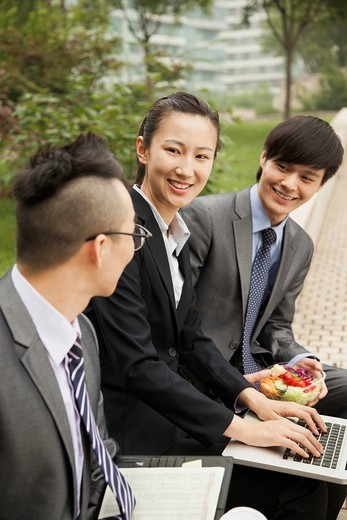 Stock Photo: 1589R-171705 Chinese business people using laptop outdoors