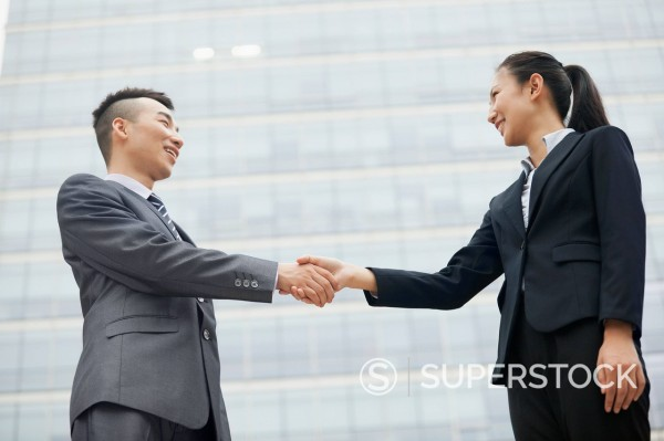 Stock Photo: 1589R-171708 Chinese business people shaking hands outdoors