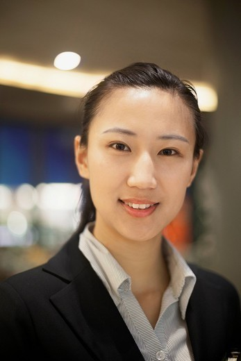 Smiling Chinese businesswoman : Stock Photo