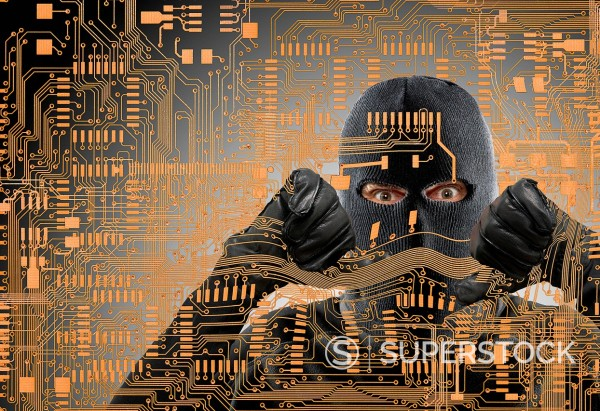 Stock Photo: 1589R-171721 Caucasian man in ski mask behind microchip pattern