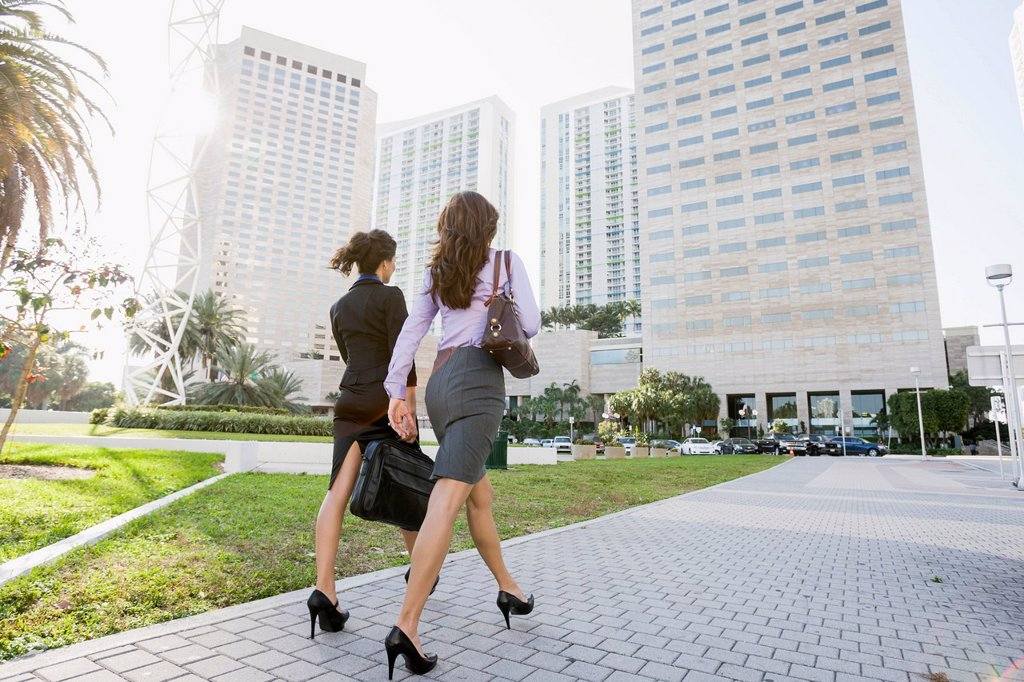 Stock Photo: 1589R-171773 Hispanic businesswomen walking together