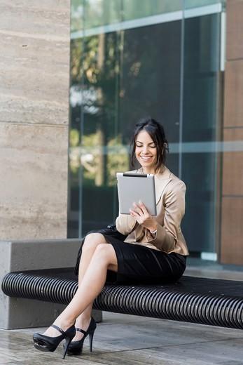 Hispanic businesswoman using digital tablet : Stock Photo