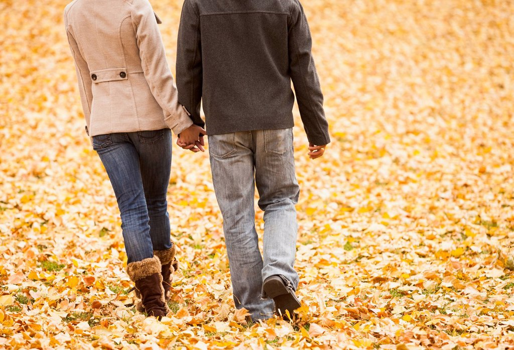 Stock Photo: 1589R-171916 Couple walking in autumn leaves