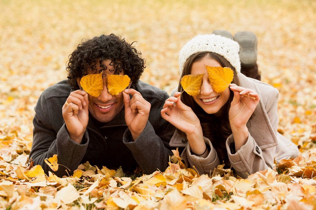 Stock Photo: 1589R-171920 Couple playing in autumn leaves