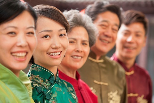 Chinese family wearing traditional clothes : Stock Photo