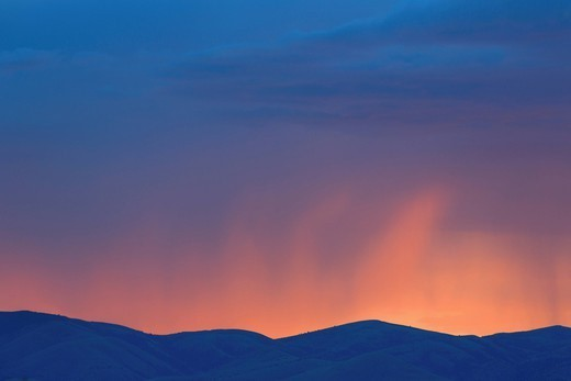 Colorful sunset over rural mountains : Stock Photo